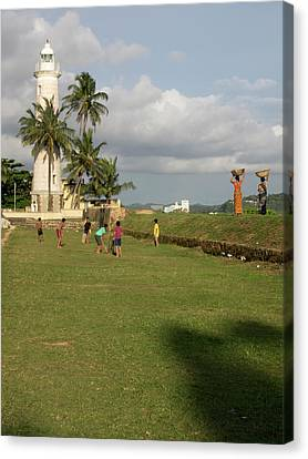 Boys Playing Cricket, Galle Lighthouse Canvas Print by Panoramic Images
