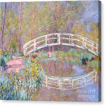 Bridge In Monet's Garden Canvas Print by Claude Monet