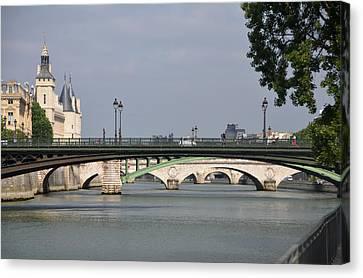Bridges Over The Seine And Conciergerie - Paris Canvas Print by RicardMN Photography