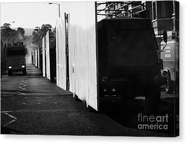 British Army Screen Bedford Trucks And Psni Water Canon On Crumlin Road At Ardoyne Shops Belfast 12t Canvas Print by Joe Fox