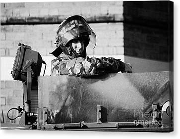 British Army Soldier In Hatch Of Armoured Land Rover On Crumlin Road At Ardoyne Shops Belfast 12th J Canvas Print by Joe Fox