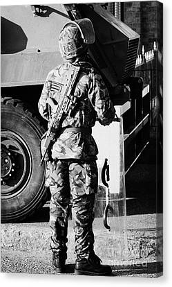 British Army Soldier In Riot Gear With Sa80 In Front Of Saxon Vehicle On Crumlin Road At Ardoyne Sho Canvas Print by Joe Fox