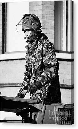 British Army Soldier In Turret Of Saxon Vehicle In Front Of Houses On Crumlin Road At Ardoyne Shops  Canvas Print by Joe Fox