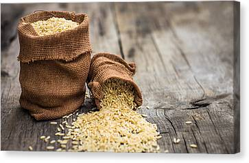 Brown Rice Bags Canvas Print by Aged Pixel