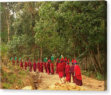 Buddhist Monks In A Losar Ceremonial Canvas Print by Jaina Mishra