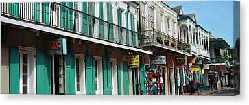 Buildings Along The Bourbon Street Canvas Print by Panoramic Images
