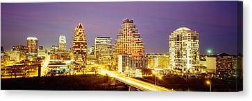 Buildings Lit Up At Dusk, Austin Canvas Print by Panoramic Images