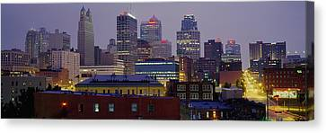 Buildings Lit Up At Dusk, Kansas City Canvas Print by Panoramic Images