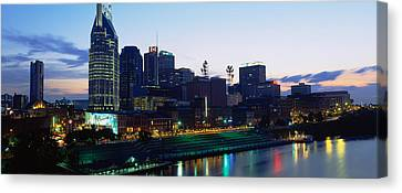 Buildings Lit Up At Dusk, Nashville Canvas Print by Panoramic Images