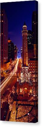 Buildings Lit Up At Night, Water Tower Canvas Print by Panoramic Images