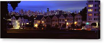 Buildings Lit Up Dusk, Alamo Square Canvas Print by Panoramic Images