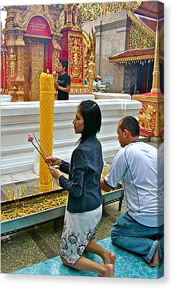 Burning Incense At Wat Phrathat Doi Sutep In Chiang Mai-thailand Canvas Print by Ruth Hager