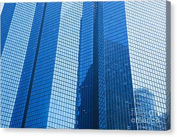 Business Skyscrapers Modern Architecture In Blue Tint Canvas Print by Michal Bednarek