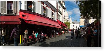Busy Street Lined With Bistros Canvas Print by Panoramic Images