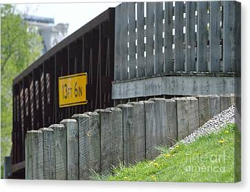 By The Bridge Canvas Print by Alys Caviness-Gober