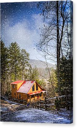 Cabin In The Snow Canvas Print by Debra and Dave Vanderlaan