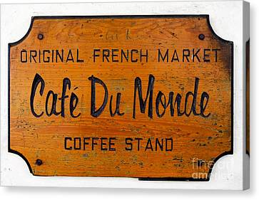 Cafe Du Monde Sign In New Orleans Louisiana Canvas Print by Paul Velgos