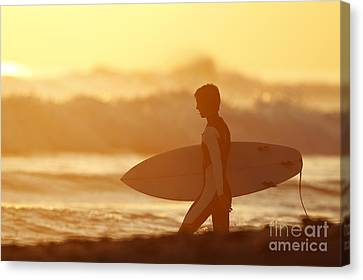 California, San Clemente, Surfer Walking Towards Ocean At Sunset. Editorial Use Only. Canvas Print by MakenaStockMedia