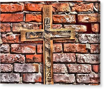 Camouflage Cross On Brick Canvas Print by Dan Sproul