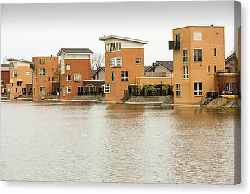 Canal Front Houses In Heerhugowaard Canvas Print by Ashley Cooper