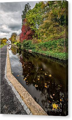 Canal Path Canvas Print by Adrian Evans