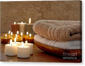 Candles And Towels In A Spa Canvas Print by Olivier Le Queinec