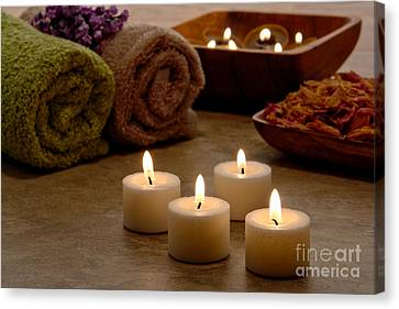 Candles In A Spa Canvas Print by Olivier Le Queinec