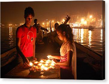 Candles In The Ganges Canvas Print by Kendell Timmers