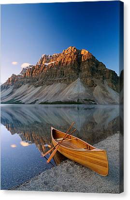 Canoe At The Lakeside, Bow Lake Canvas Print by Panoramic Images