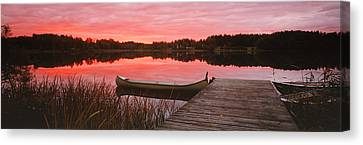 Canoe Tied To Dock On A Small Lake Canvas Print by Panoramic Images