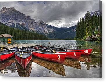Canoes On Emerald Lake Canvas Print by Darlene Bushue