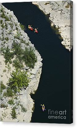 Canoes On The River Ardeche In Southern France Canvas Print by Bernard Jaubert