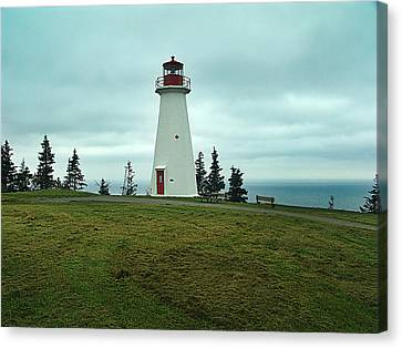 Cape George Lighthouse Canvas Print by Janet Ashworth