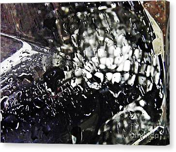 Car Light In The Rain Canvas Print by Sarah Loft