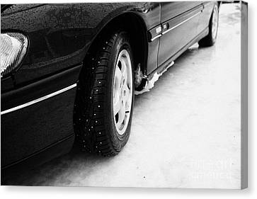 Car With Studded Winter Tyres On Ice Norway Europe Canvas Print by Joe Fox