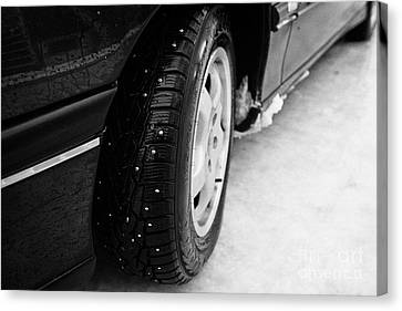 Car With Studded Winter Tyres On Ice Norway Canvas Print by Joe Fox
