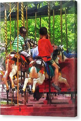 Carnivals - Friends On The Merry-go-round Canvas Print by Susan Savad