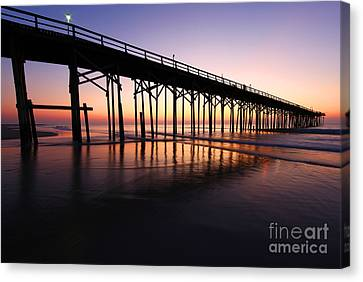 North Carolina Beach Pier - Sunrise Canvas Print by Wayne Moran