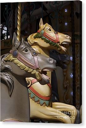 Carousel Horses Canvas Print by Bernard Jaubert