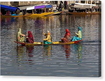 Cartoon - Ladies On A Wooden Boat On The Dal Lake With The Background Of Hoseboats Canvas Print by Ashish Agarwal