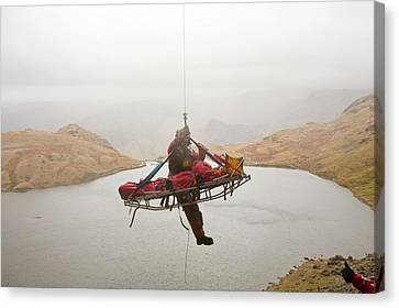 Casualty Winched Into Sea King Helicopter Canvas Print by Ashley Cooper