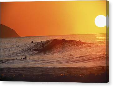 Catching A Wave At Sunset Canvas Print by Vince Cavataio - Printscapes