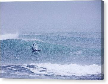 Catching A Wave In A Blizzard Canvas Print by Tim Grams
