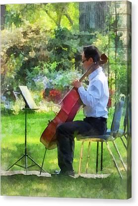 Cellist In The Garden Canvas Print by Susan Savad