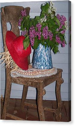 Chair With Red Hat Canvas Print by Kathleen Luther