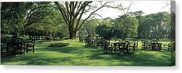 Chairs And Tables In A Lawn, Lake Canvas Print by Panoramic Images