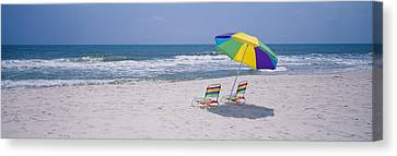 Chairs On The Beach, Gulf Of Mexico Canvas Print by Panoramic Images