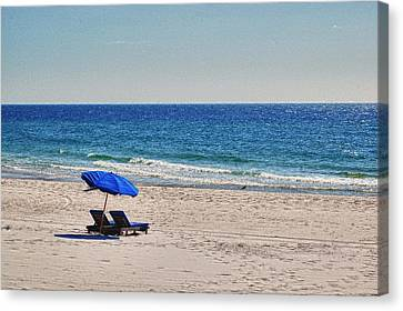 Chairs On The Beach With Umbrella Canvas Print by Michael Thomas