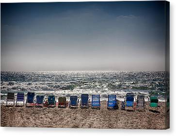 Chairs Watching The Sunset Canvas Print by Peter Tellone