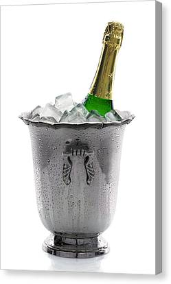 Champagne Bottle On Ice Canvas Print by Johan Swanepoel